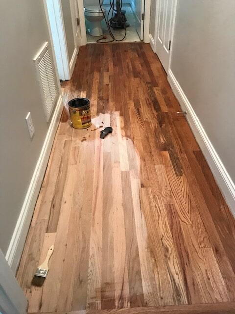 Hardwood refinishing in progress in Duluth, GA from Delta Carpet & Decor