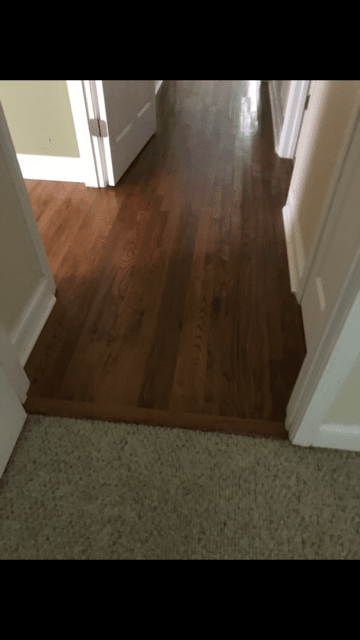 Carpet to hardwood transition installation in Lawrenceville, GA from Delta Carpet & Decor