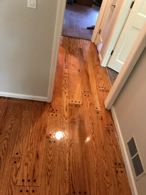 Repaired and refinished hardwood in Stone Mountain, GA from Delta Carpet & Decor