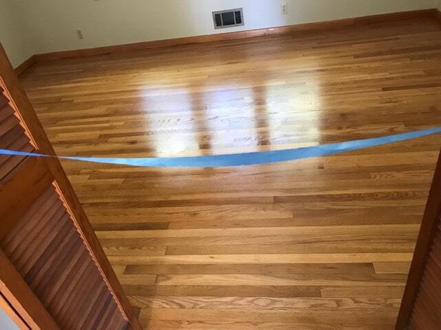 Hardwood finish in progress in Atlanta, GA from Delta Carpet & Decor