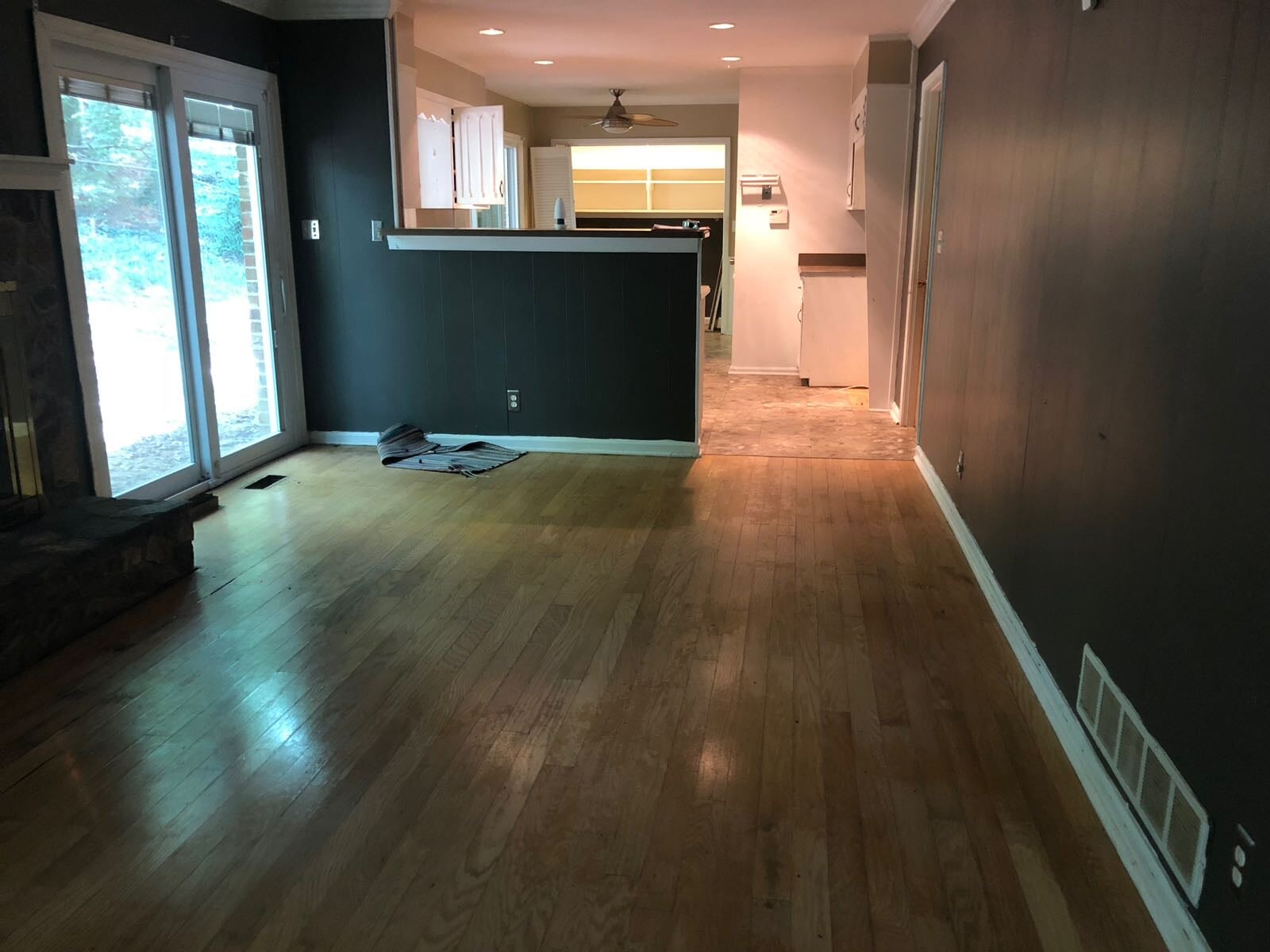 Living and dining space with new hardwood in Atlanta, GA from Delta Carpet & Decor