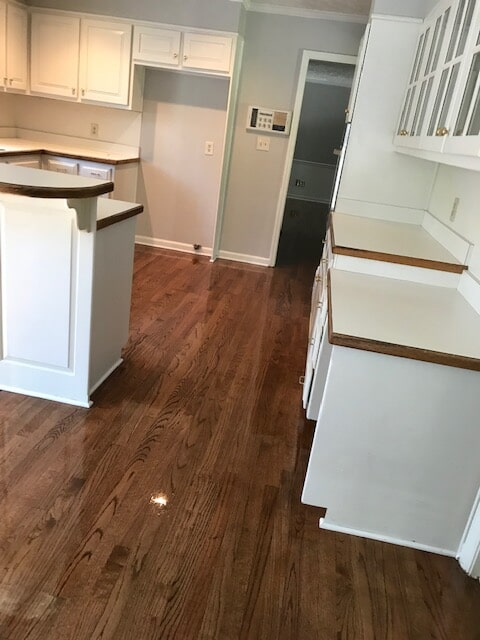 Kitchen hardwood refinish looking great in Stone Mountain, GA from Delta Carpet & Decor