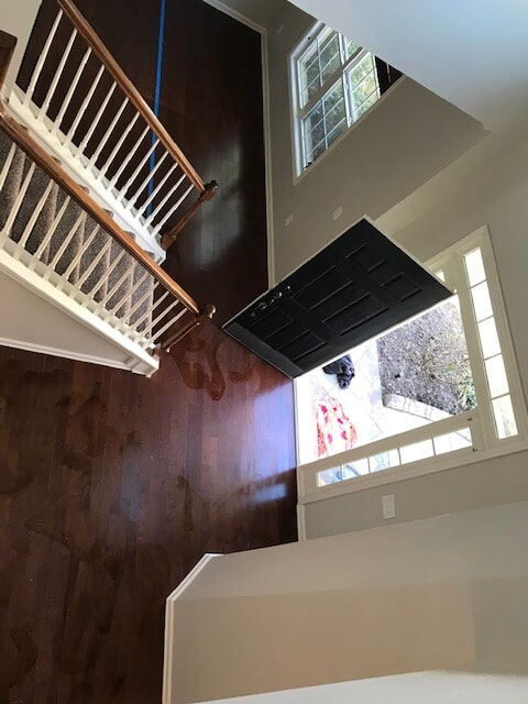 Entryway hardwood refinishing with dark tone in Duluth, GA from Delta Carpet & Decor