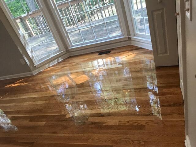 Bay windows brightening new hardwood in Duluth, GA from Delta Carpet & Decor