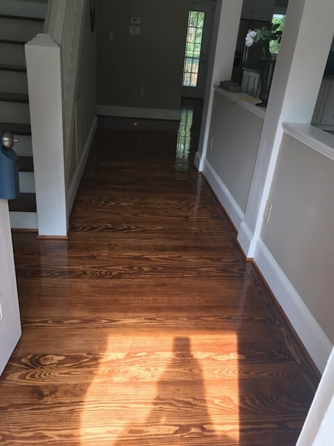 Hallway with new hardwood floor covering in Atlanta, GA from Delta Carpet & Decor