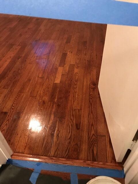 Hardwood refinish service in progress in Norcross, GA from Delta Carpet & Decor