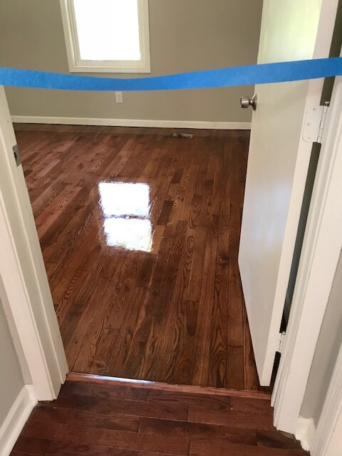 Hardwood refinish in the drying process in Stone Mountain, GA from Delta Carpet & Decor