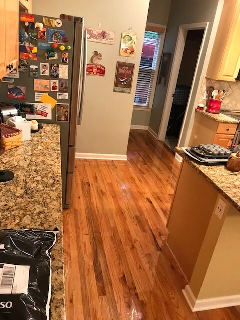 Family kitchen with new hardwood in Lawrenceville, GA from Delta Carpet & Decor