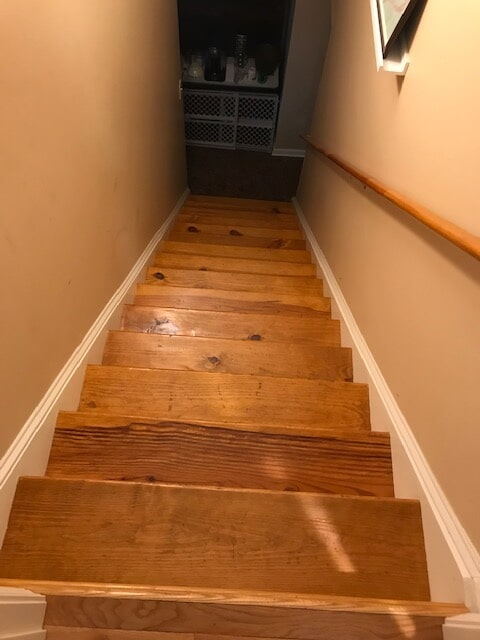 Natural hardwood staircase in Norcross, GA from Delta Carpet & Decor