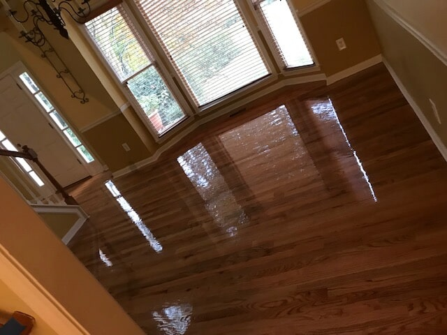 Bay windows and new hardwood go great together in Stone Mountain, GA from Delta Carpet & Decor