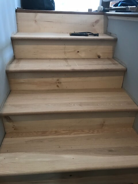 Light hardwood staircase in Duluth, GA from Delta Carpet & Decor