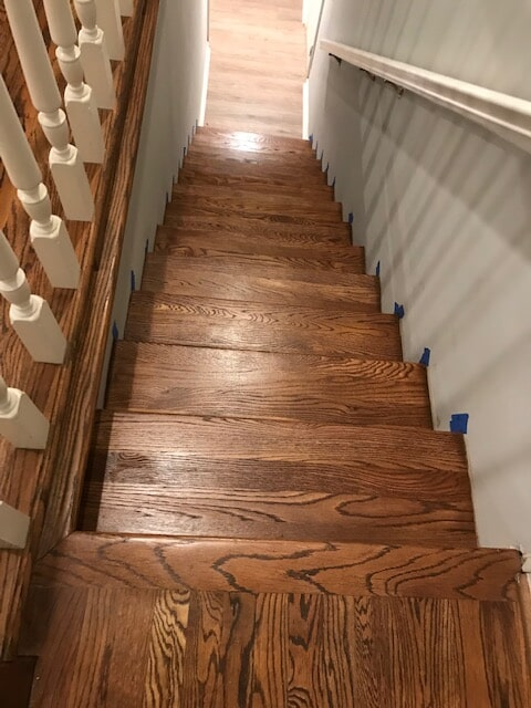 Stairs refinished with new hardwood stain in Lawrenceville, GA from Delta Carpet & Decor