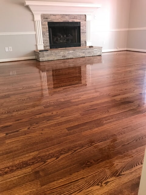 Hardwood with natural stone fireplace in Norcross, GA from Delta Carpet & Decor