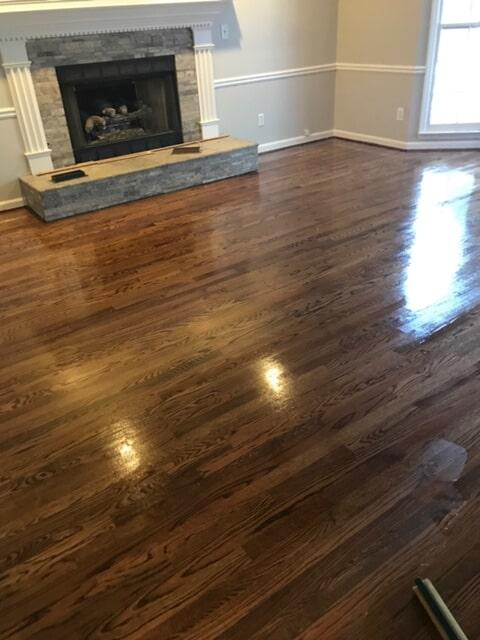 Refinished medium tone hardwood in Lawrenceville, GA from Delta Carpet & Decor