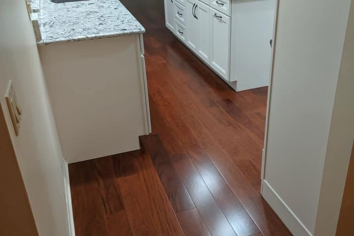 Red tone wood look kitchen flooring in Lecanto, FL from LePage Carpet & Tile
