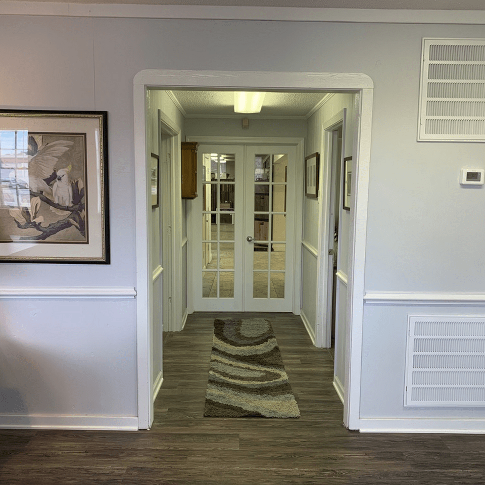 Modern flooring and hallway design at the Beach House Flooring and Tile Co. showroom