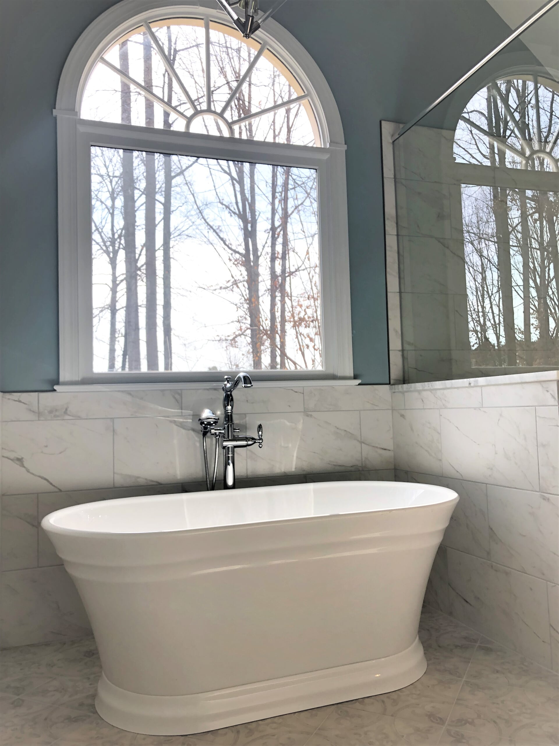 Deep white soaking tub in Cornelius, NC from LITTLE Wood Flooring & Cabinetry