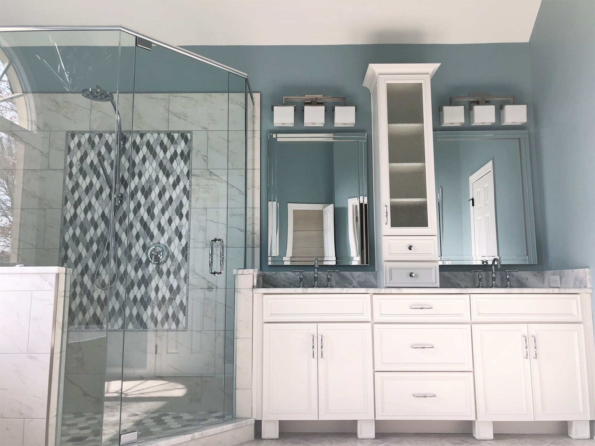 Beautiful bright bathroom renovation with blue tones in Cornelius, NC from LITTLE Wood Flooring & Cabinetry