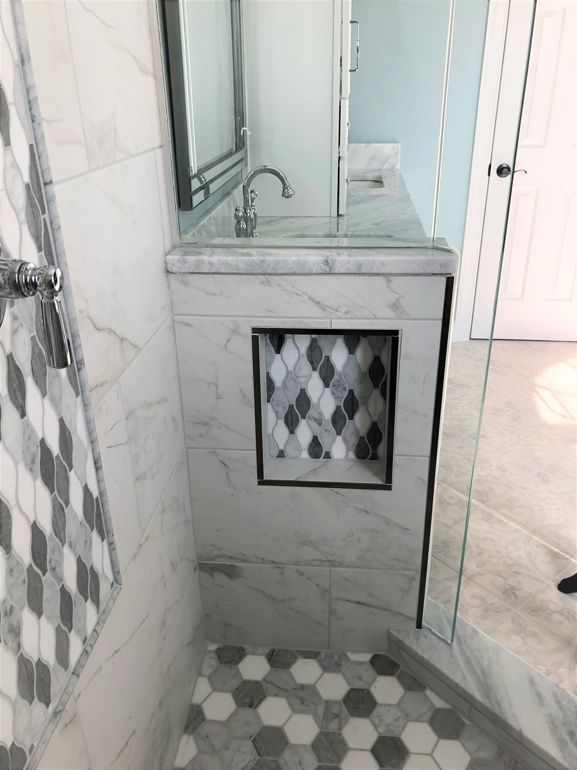 Custom mosaic tile in recessed shelf in Cornelius, NC from LITTLE Wood Flooring & Cabinetry