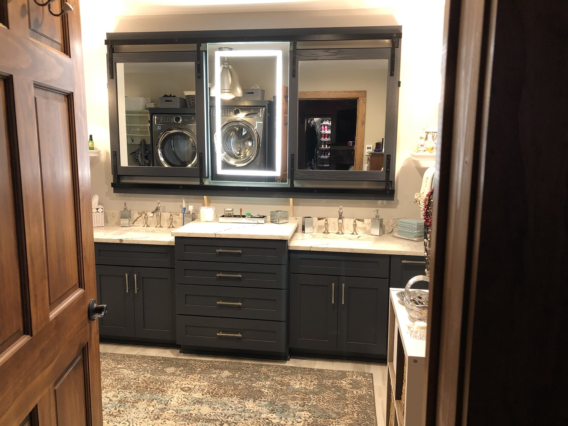 Beautiful blue tone vanity with white stone counter in Mooresville, NC from LITTLE Wood Flooring & Cabinetry