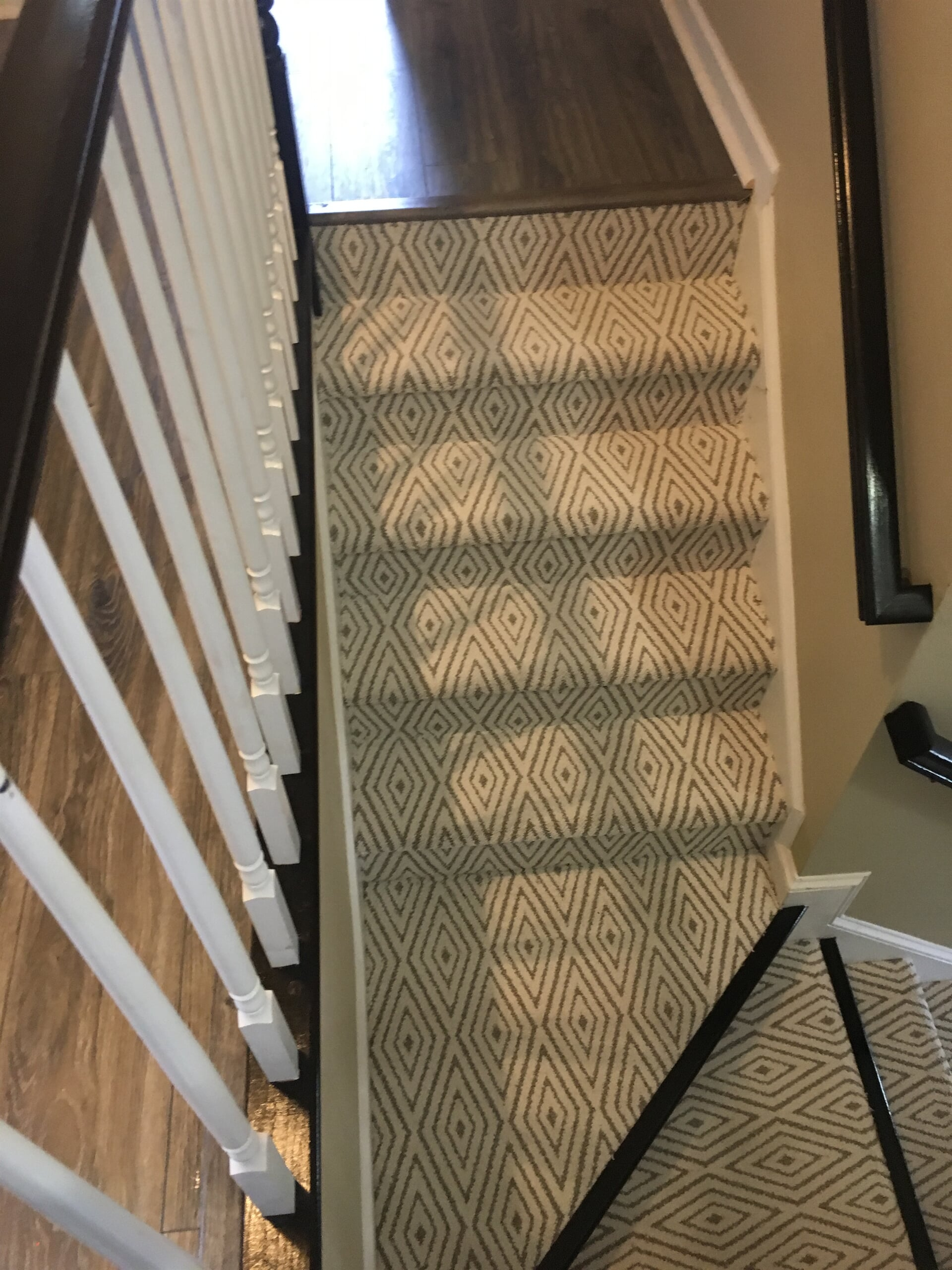Carpeted stairs with beautiful pattern in Davidson, NC from LITTLE Wood Flooring & Cabinetry