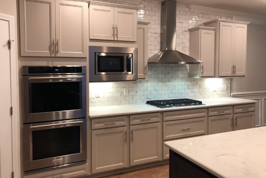 Gray cabinetry with white stone counters in Spring Hill, TN from Inspired Flooring & Design