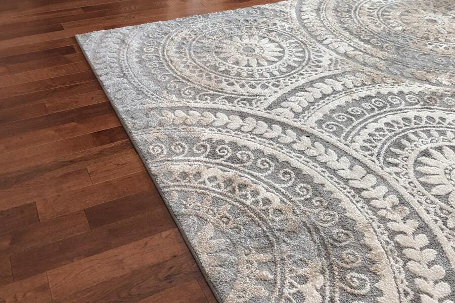 Beautiful area rug over classic hardwood in Columbia, TN from Inspired Flooring & Design