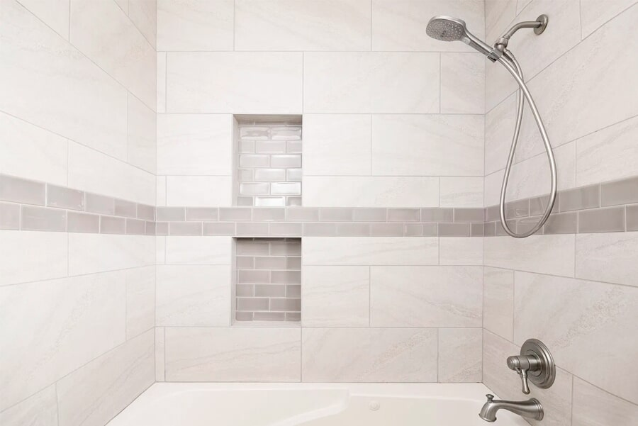 Modern shower with subway tile accents in Columbia, TN from Inspired Flooring & Design