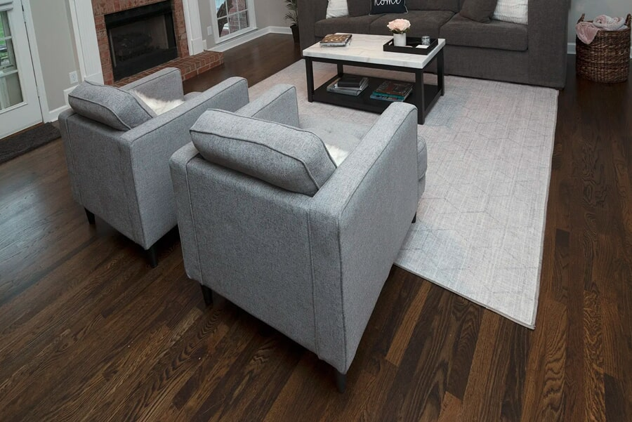 Modern living space with dark hardwood flooring in Brentwood, TN from Inspired Flooring & Design