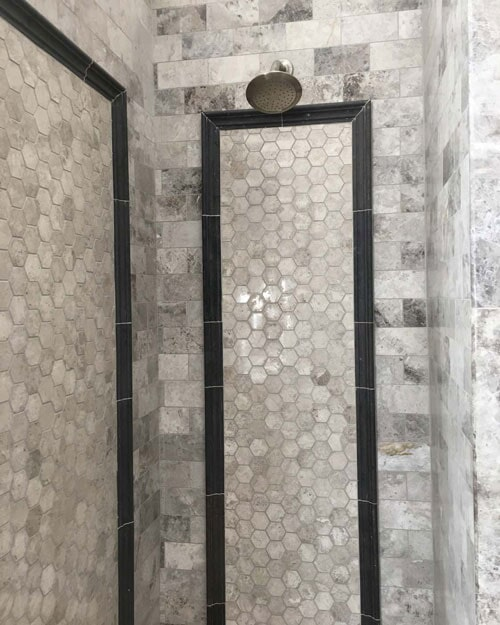 Custom shower installation with stone and glass tile accents