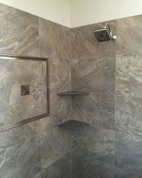 Natural stone shower with custom shelving in Rancho Cucamonga, CA from Perry's Complete Floor