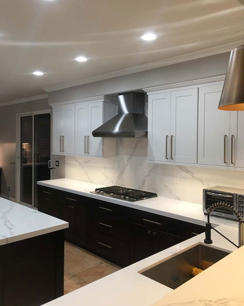Modern kitchen with marble countertops and backsplash in Upland, CA from Perry's Complete Floor