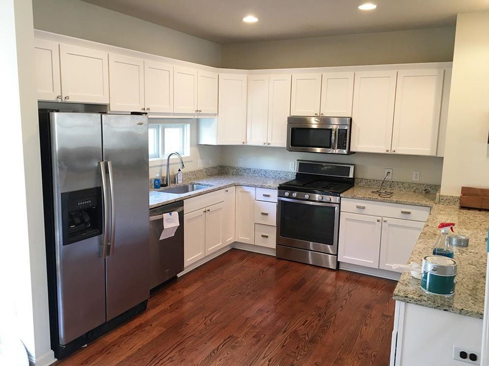 Kitchen cabinets painted and luxury vinyl flooring done D.L Richie Paint n' Decorating Center in Bethel Park, PA