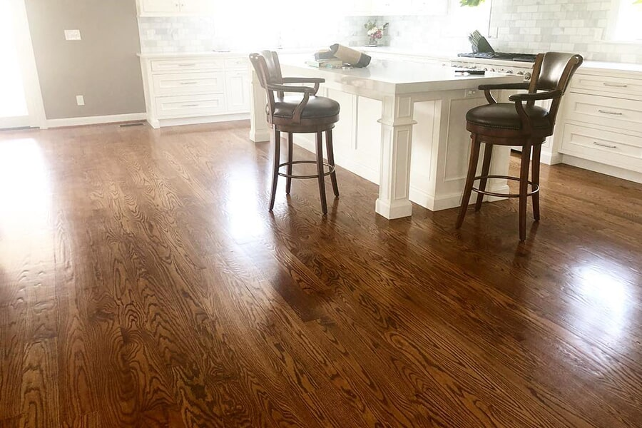 Classic hardwood in bright white kitchen in St Matthews, KY from Unique Flooring Solutions