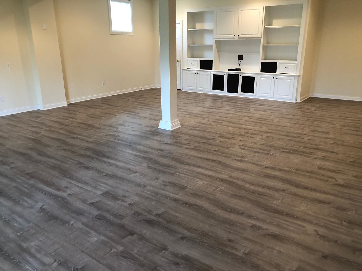 Wood look living room flooring in Clarksville, IN from Unique Flooring Solutions