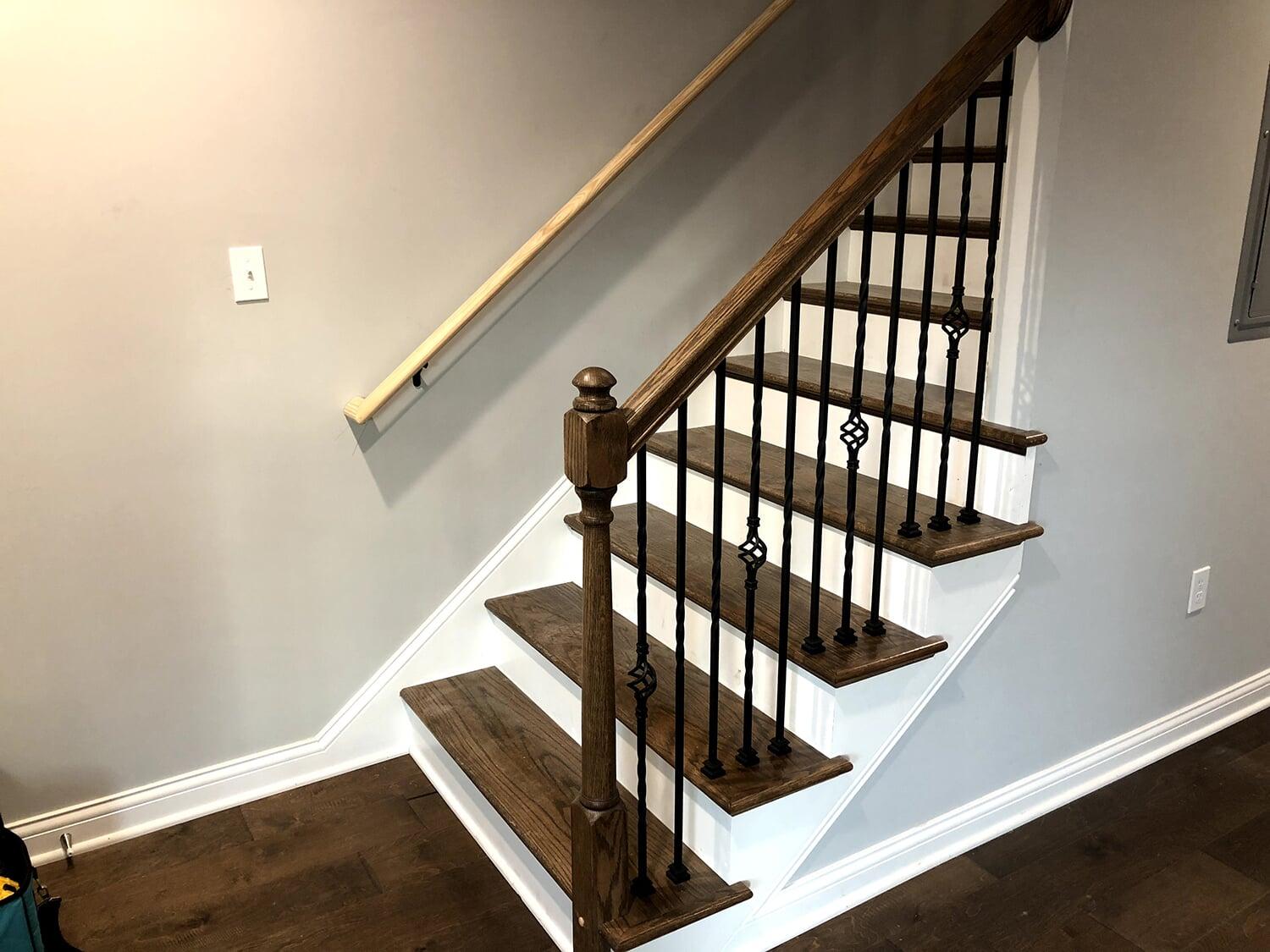 Dark wood stairway installation in Prospect, KY from Unique Flooring Solutions