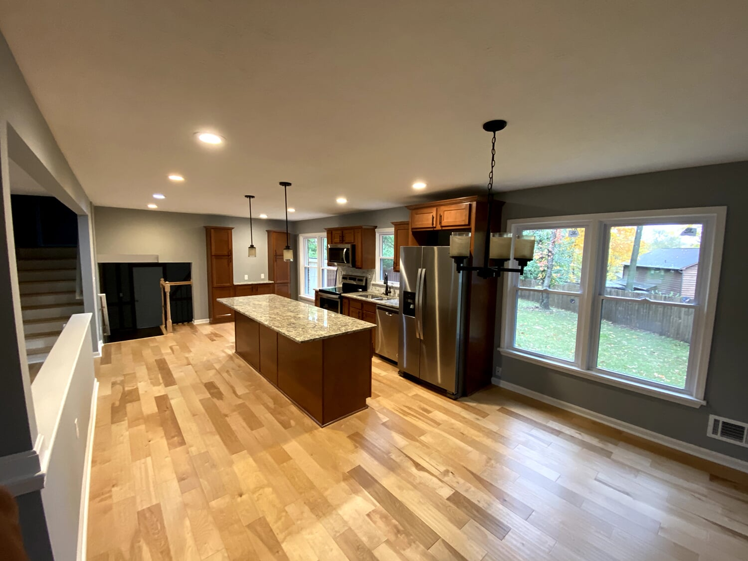 Modern kitchen renovation with wood look flooring in Goshen, KY from Unique Flooring Solutions
