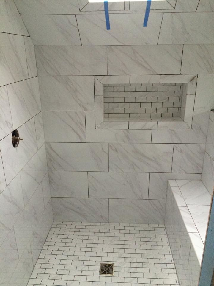 Modern white stone shower in Middletown, KY from Unique Flooring Solutions