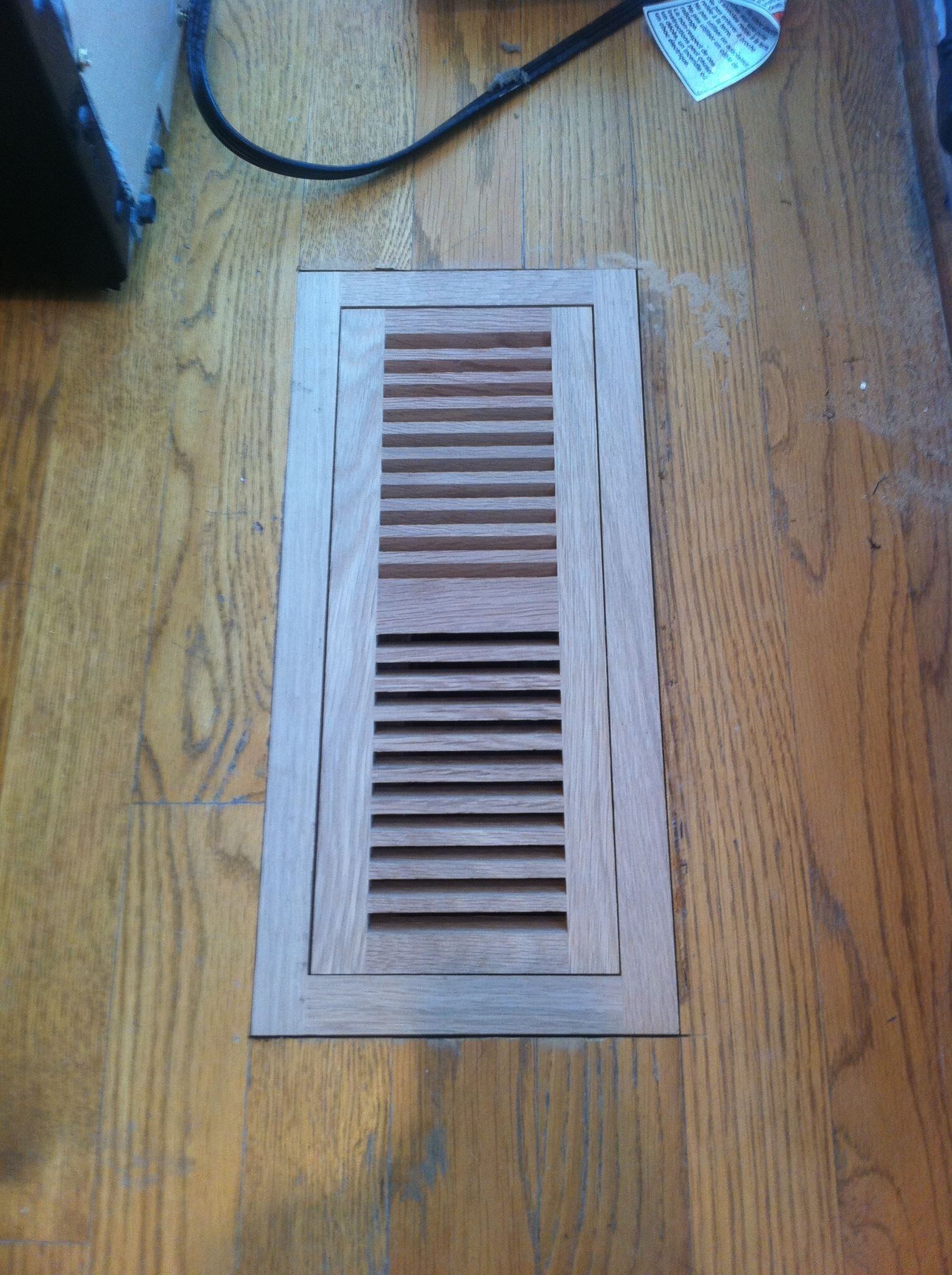 Installation around in floor air vent in St Matthews, KY from Unique Flooring Solutions