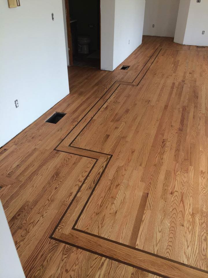 Custom hardwood flooring design in Goshen, KY from Unique Flooring Solutions