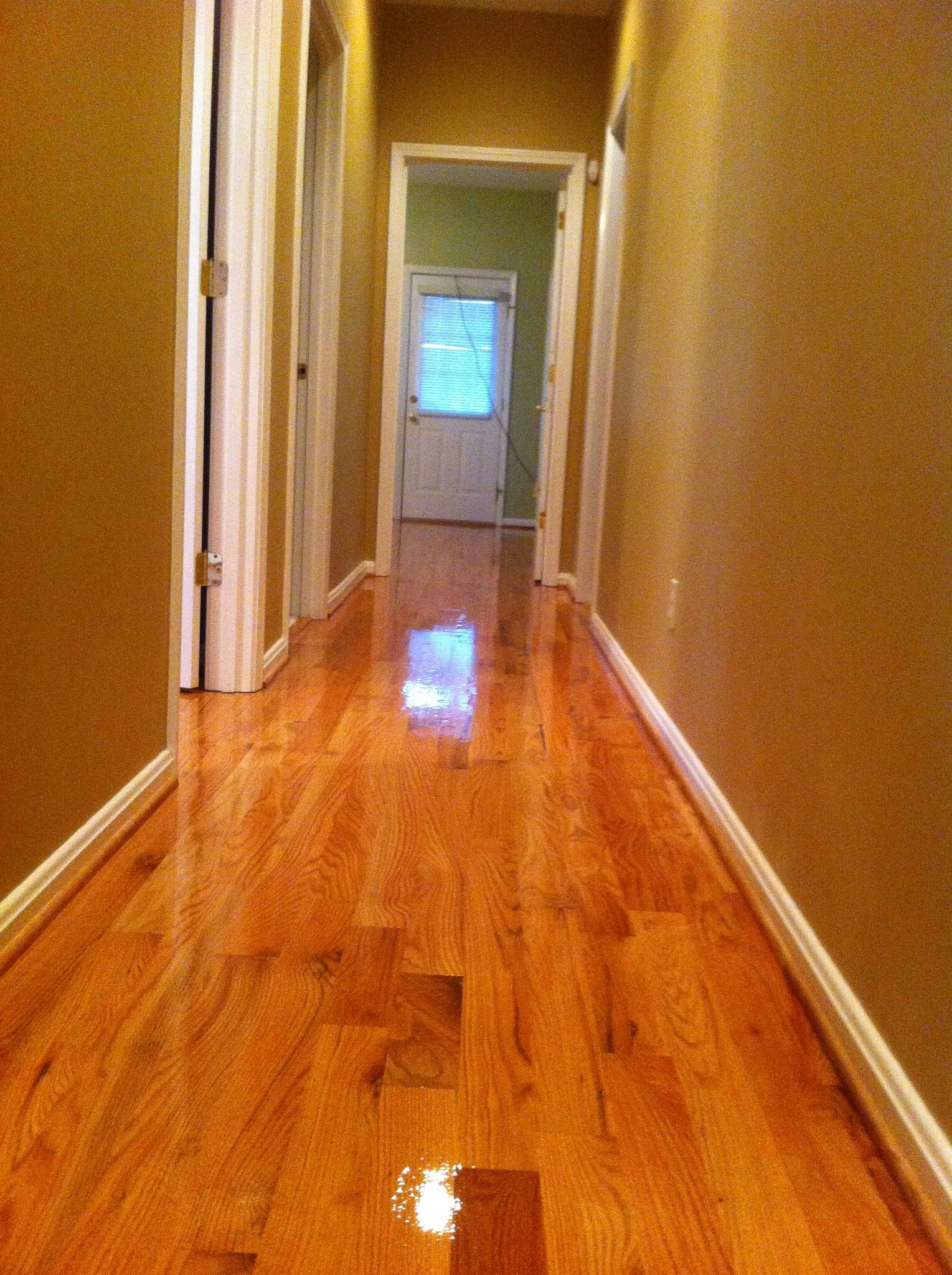 High gloss hardwood hallway in Louisville, KY from Unique Flooring Solutions