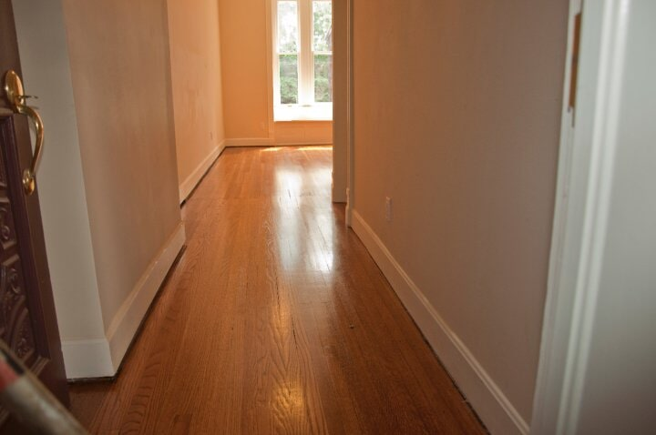 Hallway hardwood flooring installation in St Matthews, KY from Unique Flooring Solutions