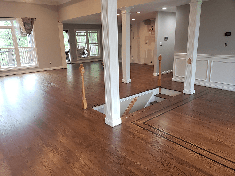 Custom hardwood installation around staircase in Crestwood, KY from Unique Flooring Solutions
