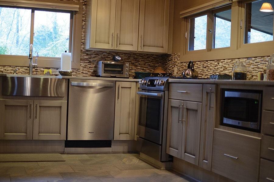 Glass tile backsplash and tile flooring