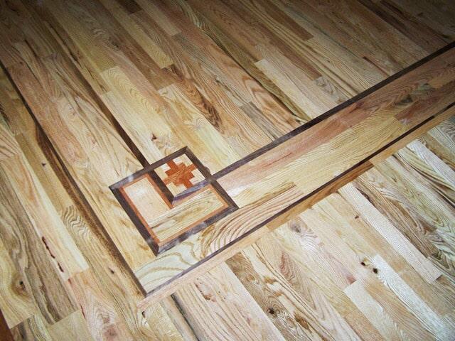 Custom hardwood border mark from Schmidt Custom Floors in Boulder, CO