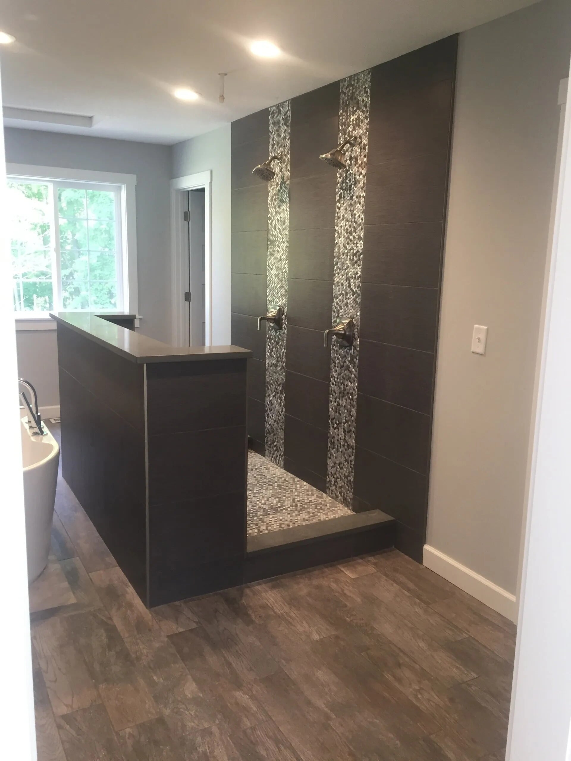 Custom open shower design in Burnsville, MN from Infinite Floors and More