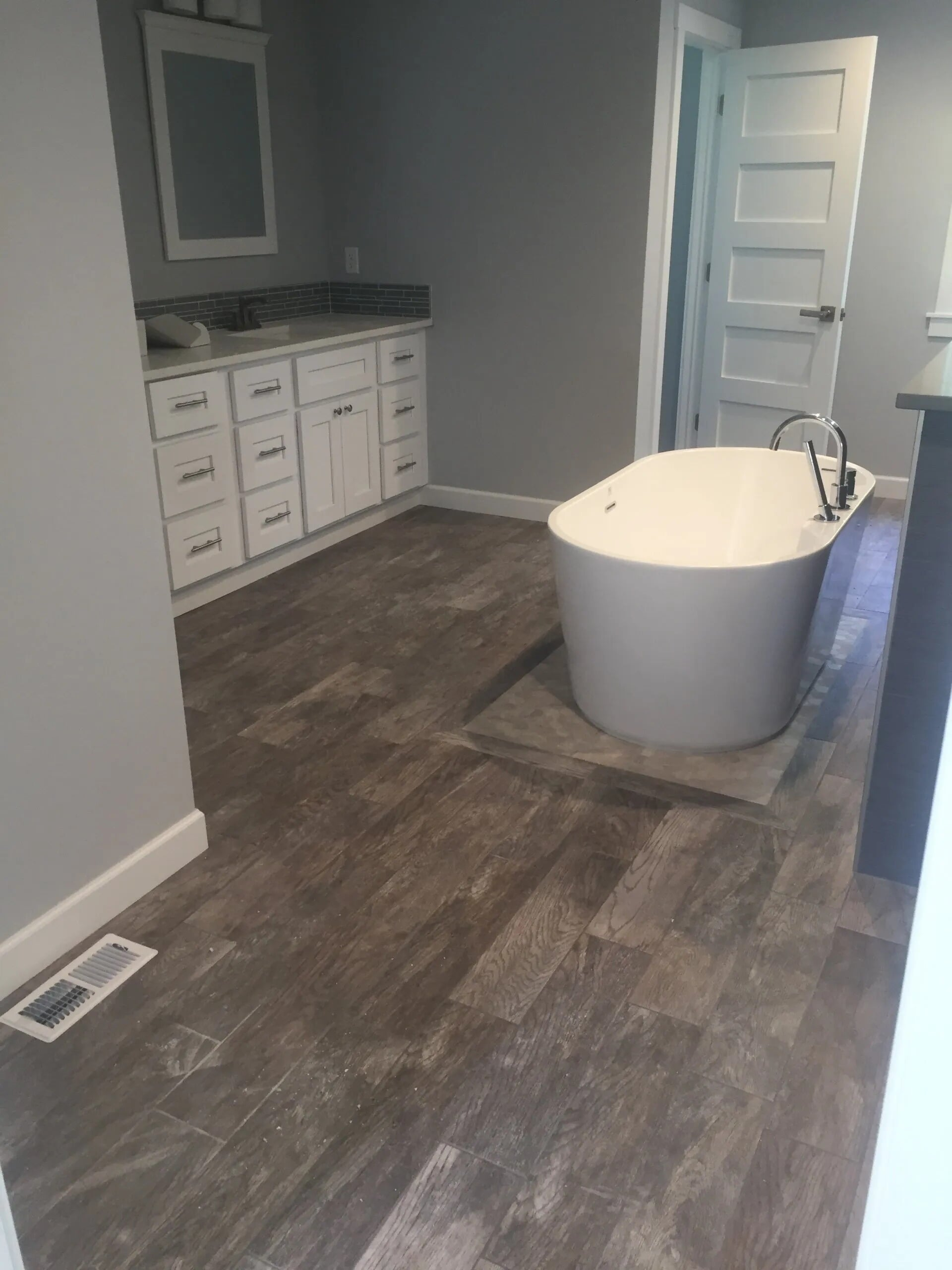 Wood look bathroom flooring install in Lakeville, MN from Infinite Floors and More