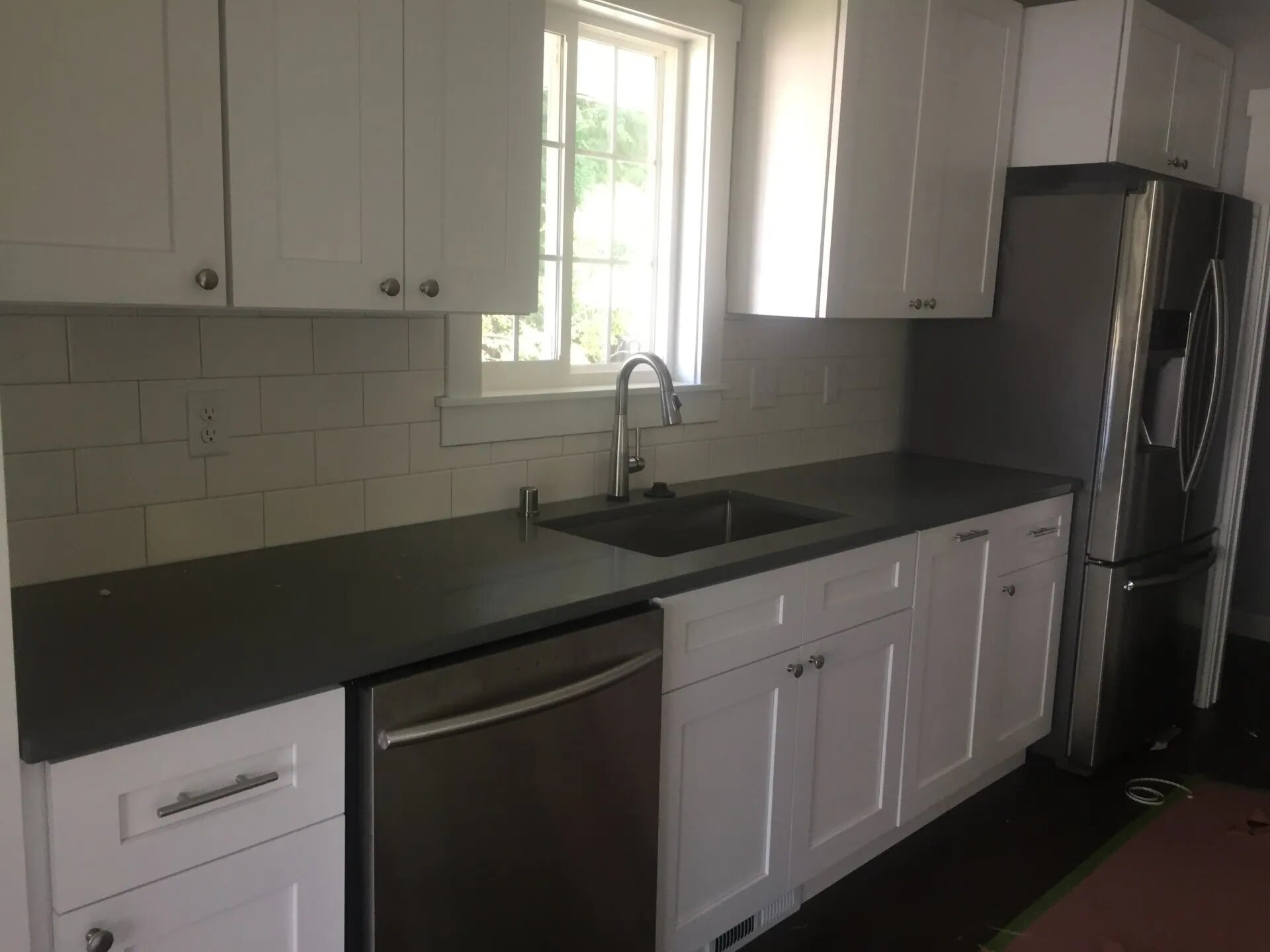 White cabinets with dark coutertops in Burnsville, MN from Infinite Floors and More
