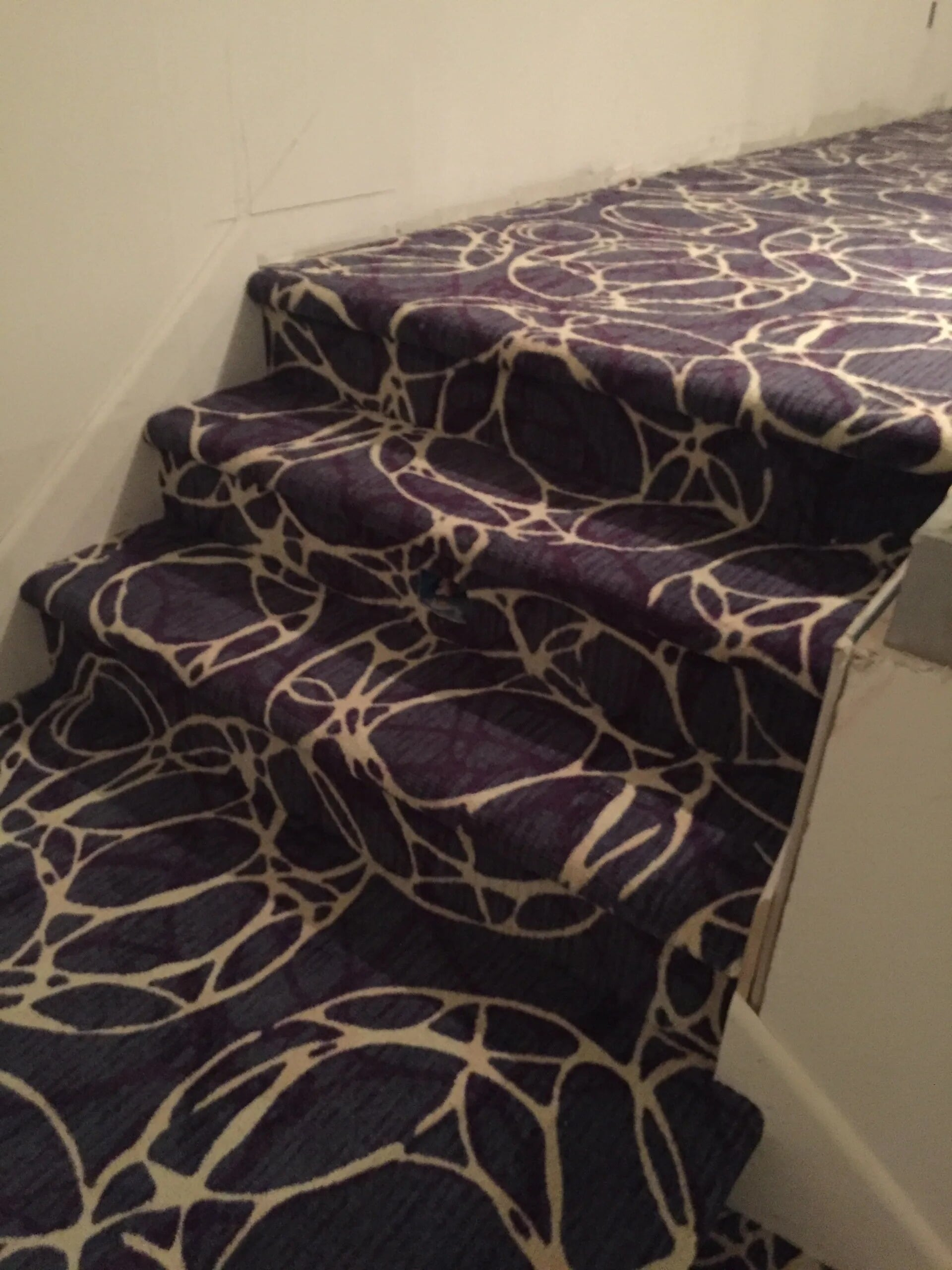 Patterned carpet stairs in Savage, MN from Infinite Floors and More