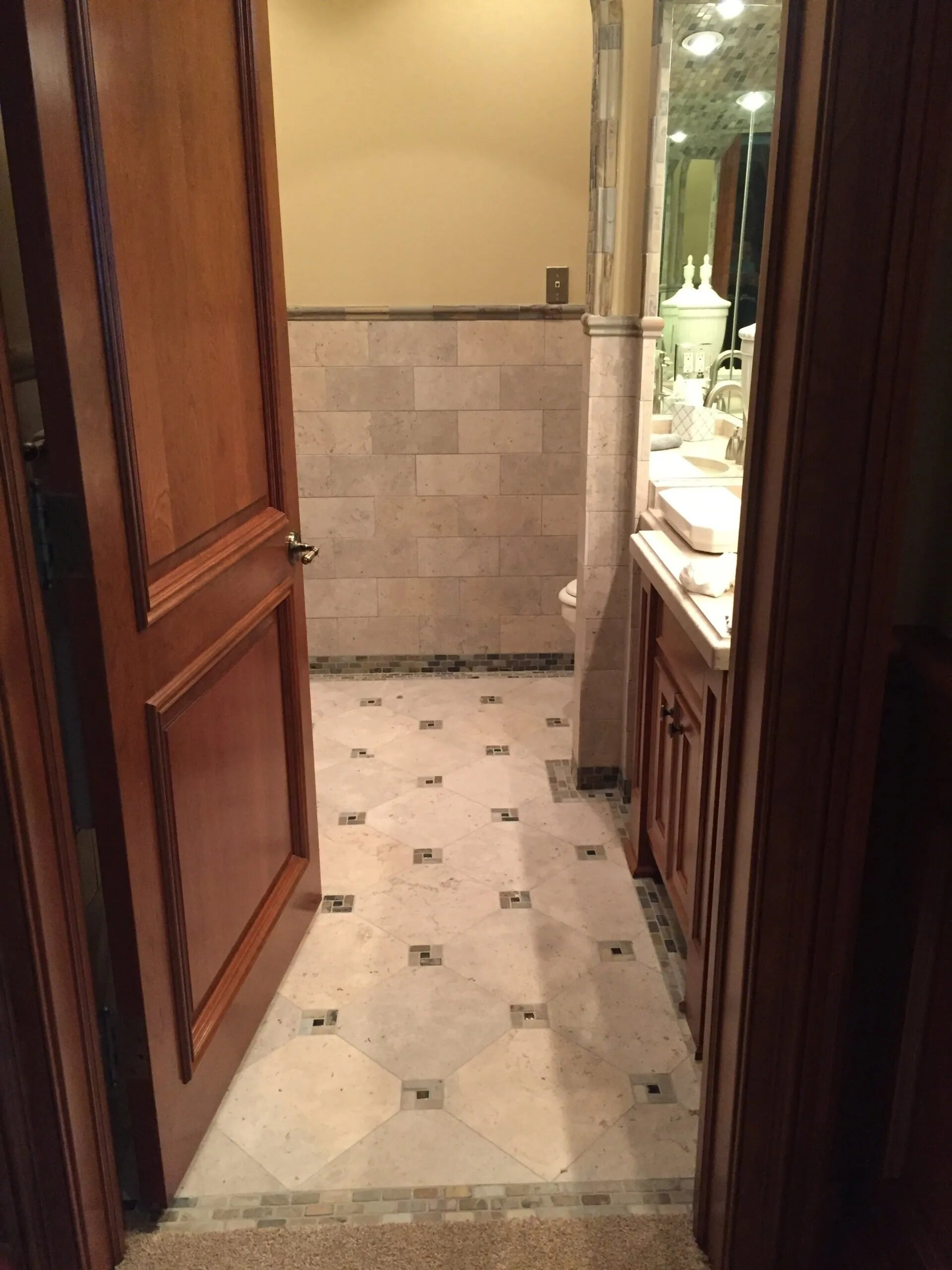 Bathroom tile with dark accents in Lakeville, MN from Infinite Floors and More